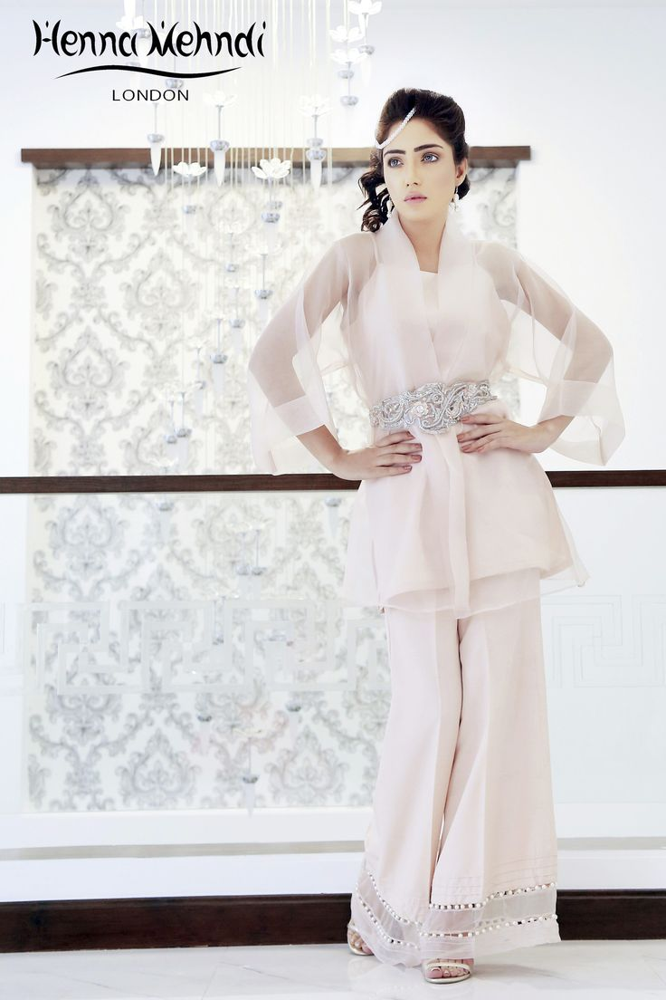 Nude pink organza wrap over jacket with embroidered belt. Included is a nude pink raw silk camisole/inner shirt. Available with a nude pink raw silk trousers, c