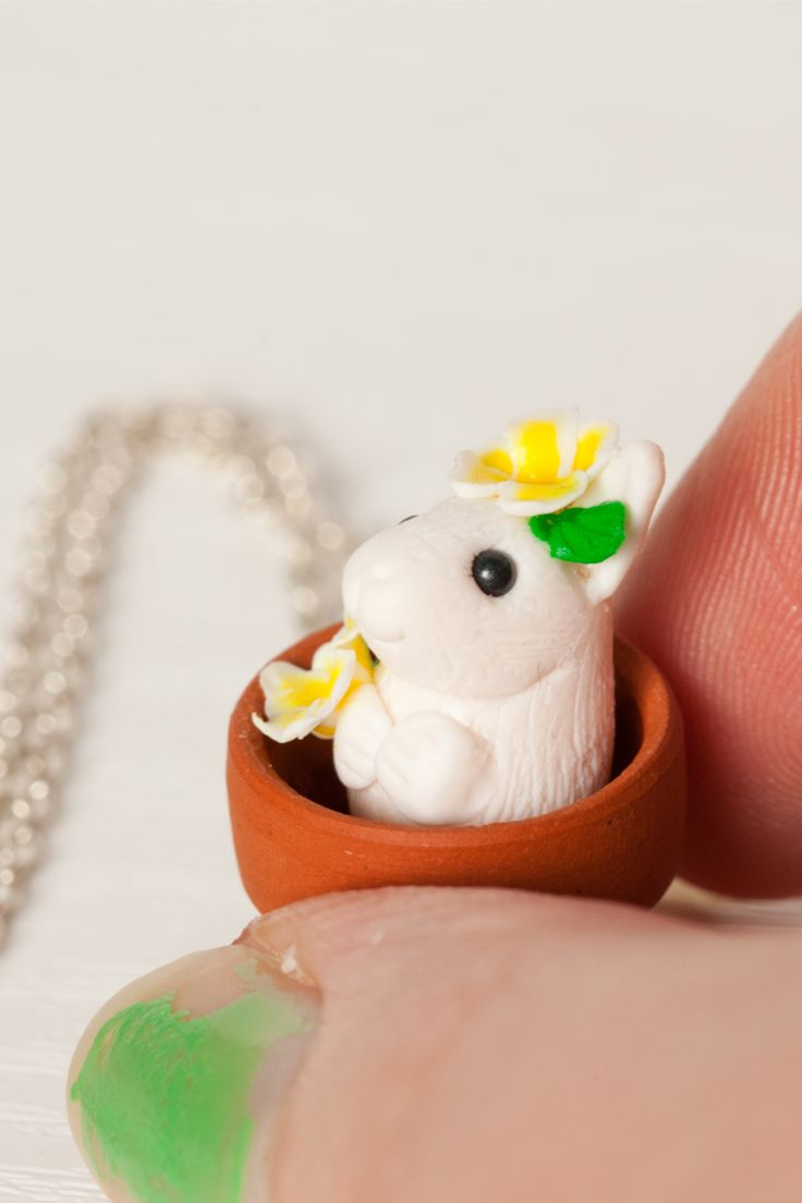 An adorable miniature bunny charm necklace. Part of the pot pets collection this little rabbit sits in a terracotta pot among beautiful primrose flowers. Guaranteed to make any bunny lover smile. www.gizzysgifts.co.uk