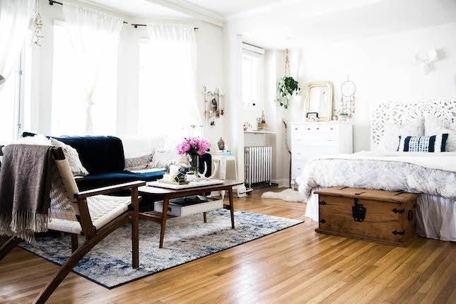 16 Small Space Rugs Ideas That Make A Big Statement Brit Co Tiny Studio Apartments Studio Apartment Decorating Studio Apartment Layout