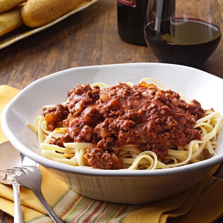 Savory Spaghetti Sauce Recipe -This fresh-tasting spaghetti sauce is a real crowd-pleaser. I rely on this flavorful recipe often. It tastes especially good in the summer made with fresh garden herbs. —Anne Heinonen, Howell, Michigan