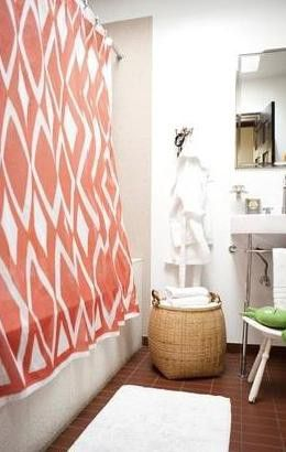 11 essential bathroom organizers that get the job done.: Store toilet paper in a basket.