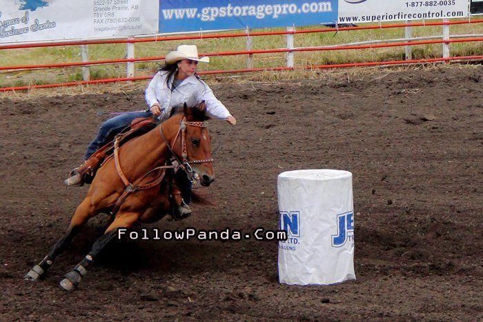 Cowgirl Barrel Racing at Teepee Creek Stampede Rodeo Event - County of Grande Prairie, Alberta, Canada | FollowPanda.Com