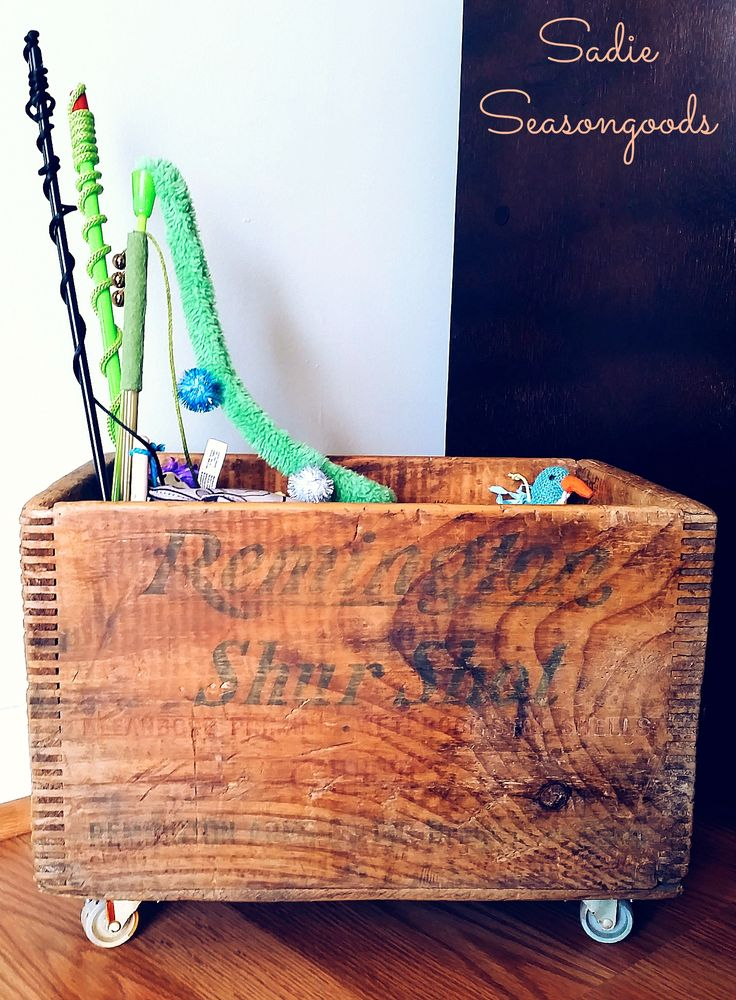 Vintage industrial wood crate on wheels to hold cat toys by Sadie Seasongoods