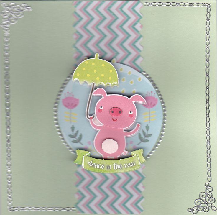 """carte d'anniversaire """"chantons sous la pluie"""" taille de 15 X 15 cm carte double représentant un cochon sous sont parapluie en relief fourni avec l'enveloppe assortie carte et enveloppe de couleur vert claire possibilité de la personnaliser"""