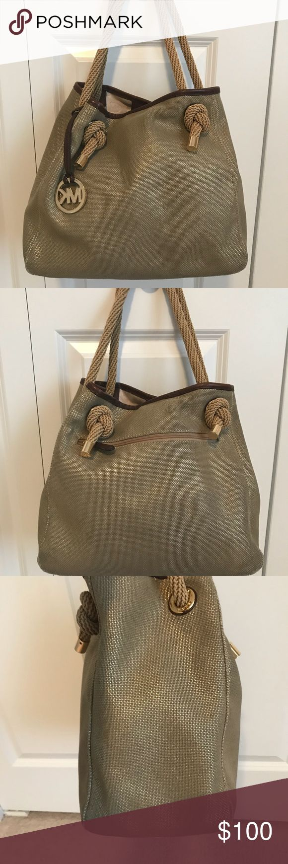 Michael Kors Nautical Tote Bag Michael Kors nautical tote bag. Gold shimmer with rope straps. Slouchy. Very roomy with multiple pockets on the inside. Wear on the bottom corners and leather trim, overall in good used condition. Michael Kors Bags Totes