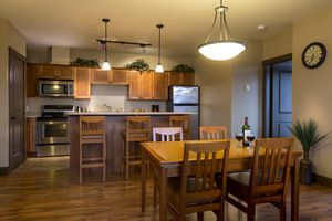 Open concept kitchen and dining area at Palliser Lodge by Kicking Horse Lodging