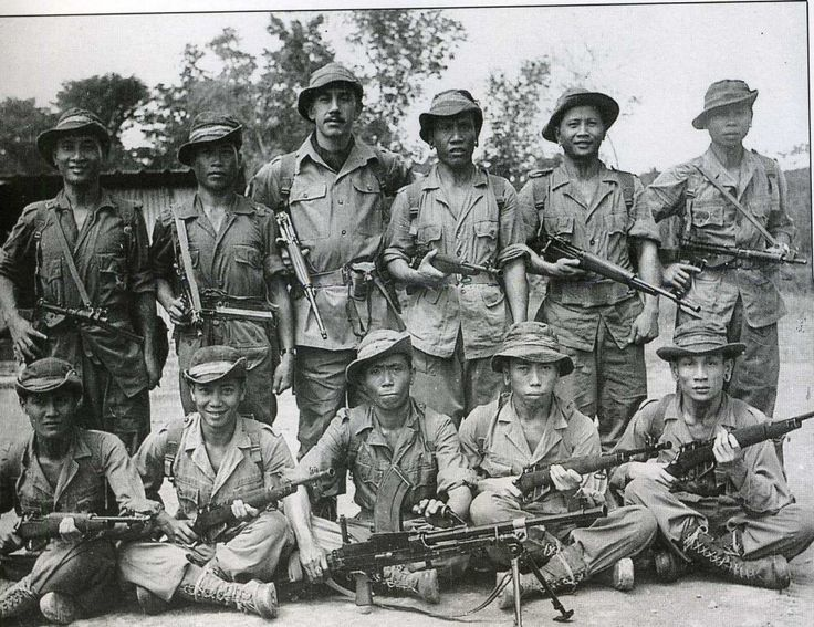 """""""This Iban patrol, posing with their British officer, is about to set off on a patrol during the Malayan emergency"""""""