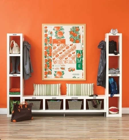 Great way to organize the hallway - and the orange wall is gorgeous.