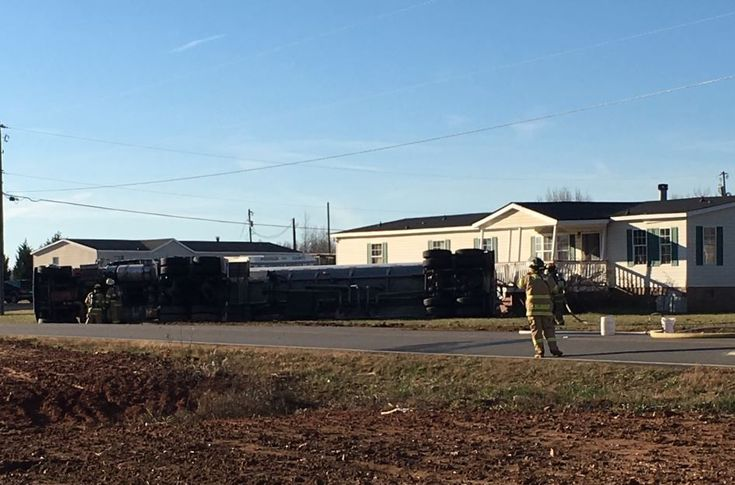 Road closed after tanker carrying aviation fuel overturns, hits utility pole & home - FOX Carolina