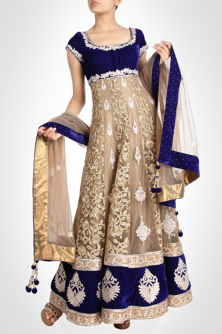 Manish Chotrani collection | Anarkali - This exceptionally gorgeous gold anarkali surfaced on lustrous backdrop will make others go green with envy. The design is uplifted by the blue velvet hem, and bodice enriched with embroidery.