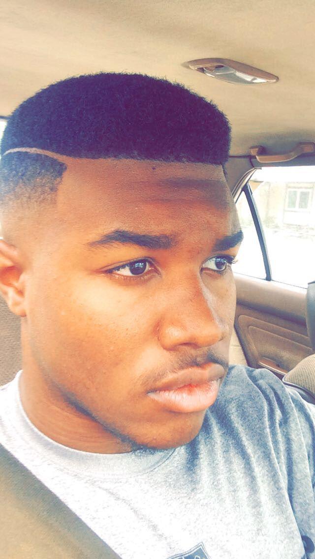 Black men hair cut with the part.