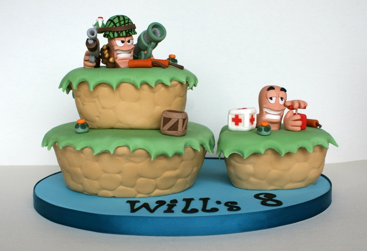 This fantastic Worms cake was made by Nicola for her son's birthday.    (Photo and cake credit: Nicola @ http://www.smallthingsiced.co.uk/)