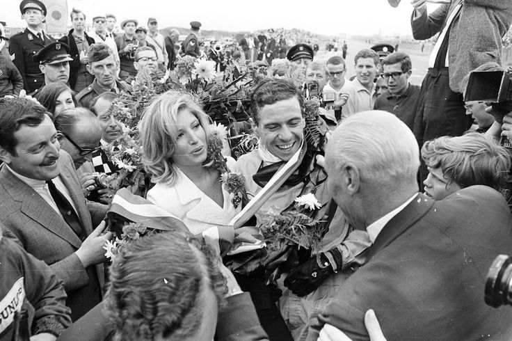 1965 Dutch GP @ Zandvoort; Jim Clark and the italian actress Monica Vitti celebrating the win on Lotus - Climax. Stewart on BRM came 2nd and Gurney on Brabham - Climax 3rd.