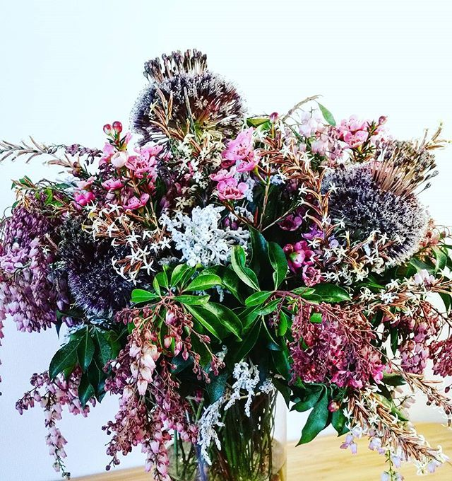 """Delicious wild arrangement with ornamental onion flowers and """"curry and rice"""" flowers"""