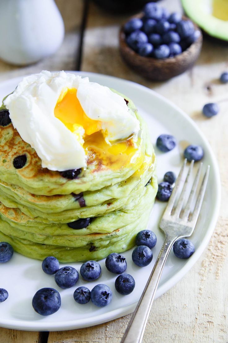 These avocado pancakes are packed with fresh blueberries, fluffy, thick and when topped with a poached egg, the perfect combination of savory and sweet. @ca_avocados #sponsored