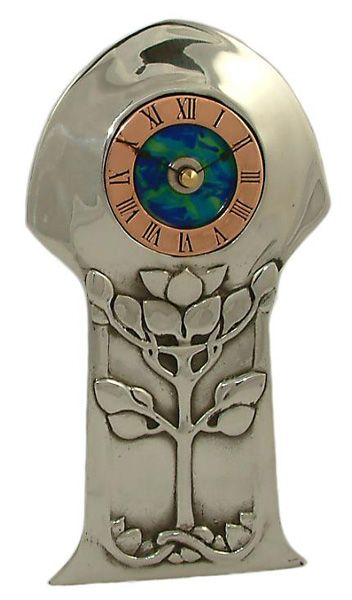 Archibald Knox Clock - Polished Pewter front decorated with honesty leaves Features enamelled blue