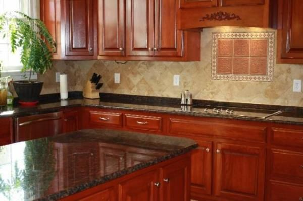 Medium cherry cabinets and granite granite counters with for Cherry kitchen cabinets with black granite