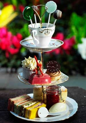 """Afternoon Tea. but I haven't had the """"Mad Hatter"""" version which is served in the beautiful Courtyard Garden of The Sanderson Hotel, London England"""