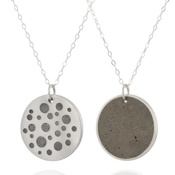 Double Sided Circles Concrete and Silver Necklace, by BAARA Jewelry. A minimalist, geometric necklace that can be worn two ways. On one side - a sterling silver plate with holes, a bit similar to a star constellation, through which the concrete can be seen. On the other side a full concrete circle.