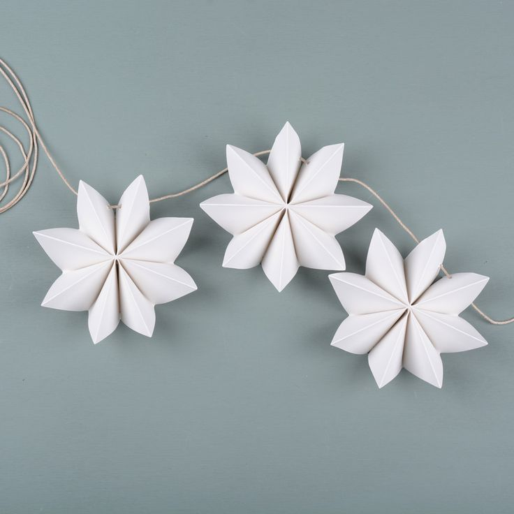 Paper flower garland Here are instructions on how to make a festive garland to brighten up your day. You will need: 100-200 gram A4 paper, cutting tool, cutting mat, stapler, awl and some string. H…