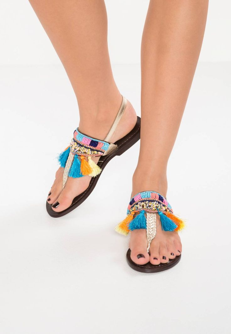 Ilse Jacobsen. FRIXA - T-bar sandals - gold. Pattern:colourful. Sole:synthetics. Details:tassels. Padding type:Cold padding. Shoe tip:open. Heel type:flat. Lining:leather. detail:sequins,rhinestones,elasticated. shoe fastener:buckle/bow. Fabr...