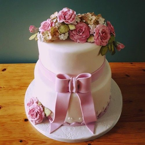 wedding cake with bow and sugar flowers