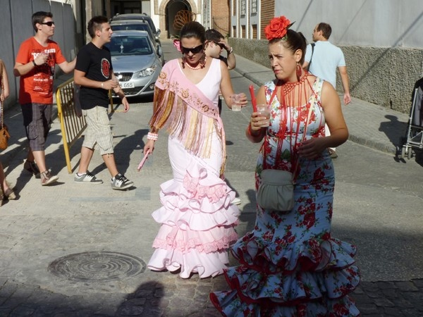 Improve your conversational skills in Spanish fast. (photo: Women wearing flamenco dresses in Andalusia)
