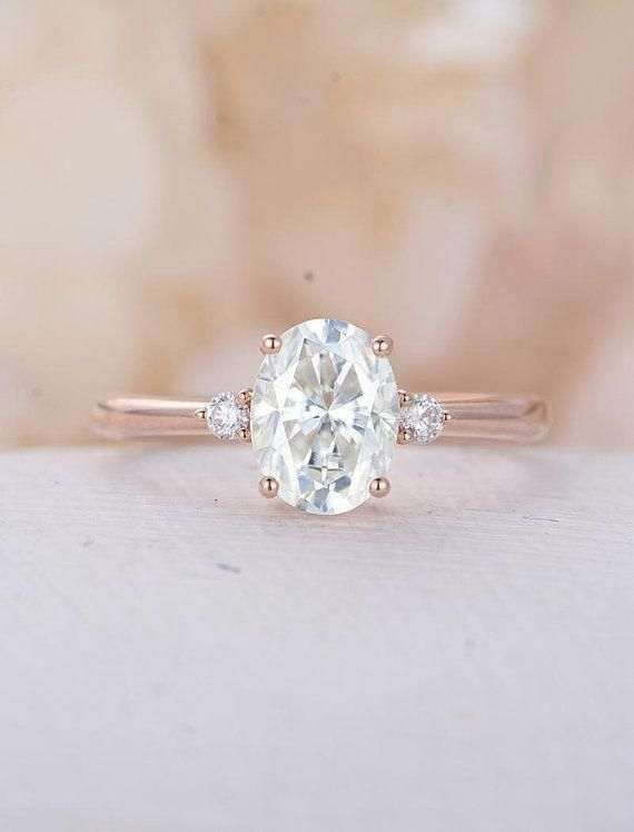 6a61d5f553cd7 Pretty 3 stone rose gold moissanite engagement ring Completely