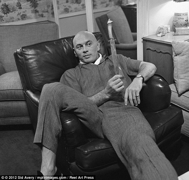 Hollywood royalty: Yul Brynner photographed at his Beverly Hills home playing with a prop from The King and I in 1958
