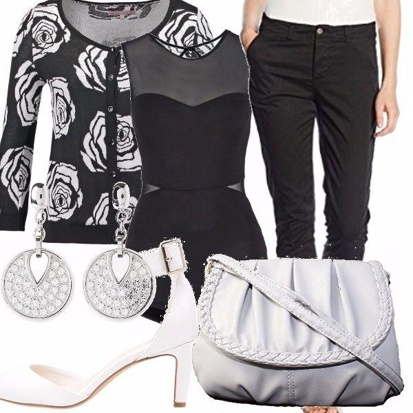 Ultime sere per sfoggiare gli acquisti estivi. Vediamo come andare a una serata con gli amici? Pantaloni neri chino, abbinati a body modellante nero e in velo, accessori tutti bianchi e golfino bianco e nero per la sera.