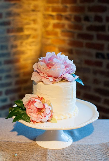 Brides: One-Tier White Cake Topped with Peonies. A one-tier white wedding cake topped with oversize pink peonies, created by The Cake Sisters.