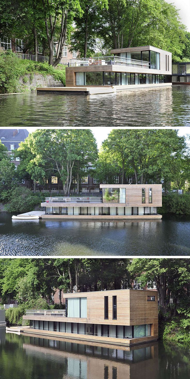 11 Awesome Examples Of Modern House Boats // This floating home has most of the living space on the bottom floor with a deck and kitchen area on overlooking the rest of the canal.
