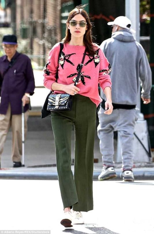 8327cac5551b Alexa Chung in a printed pink sweater paired with army green pants ...