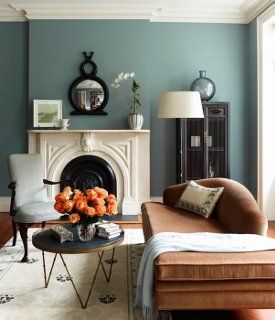 Cream, duck-egg blue and camel - a sublime combination. This room is to die foor, we particularly love the cream fire-place!