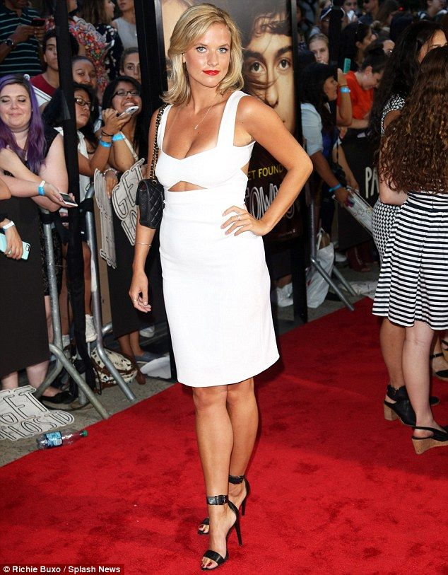 Blonde beauty: Kristine rocked a clinging white dress with a triangular cut out under the ...