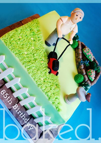 Gardening themed cake for a gardening enthusiast. Man mowing with flwoer beds and grass.