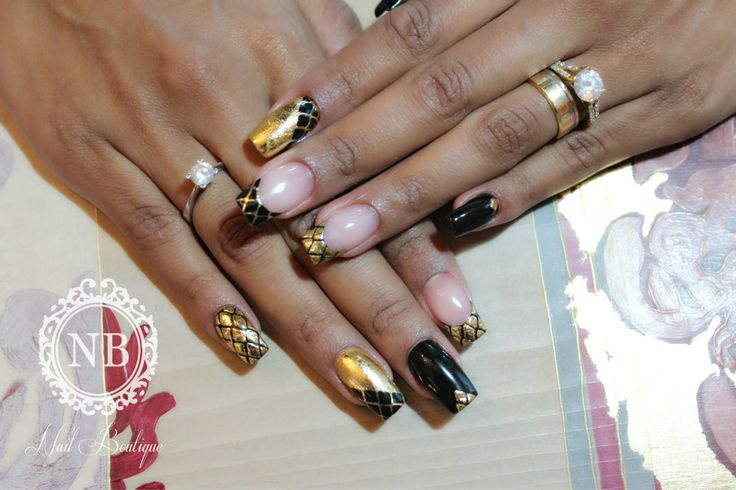 Black and golden manicure. Perfect nails