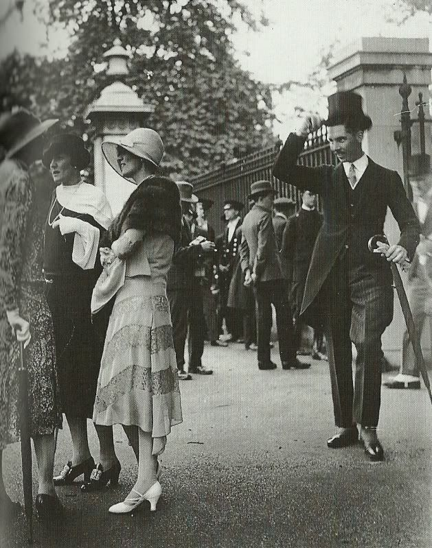 A gentlemen tips his hat to a group of ladies in this 1920's photo. I wish men still did that.