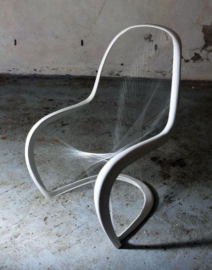 This chair is defined by its space, with near invisible strings as the seat, is the most captivating part of this furniture.