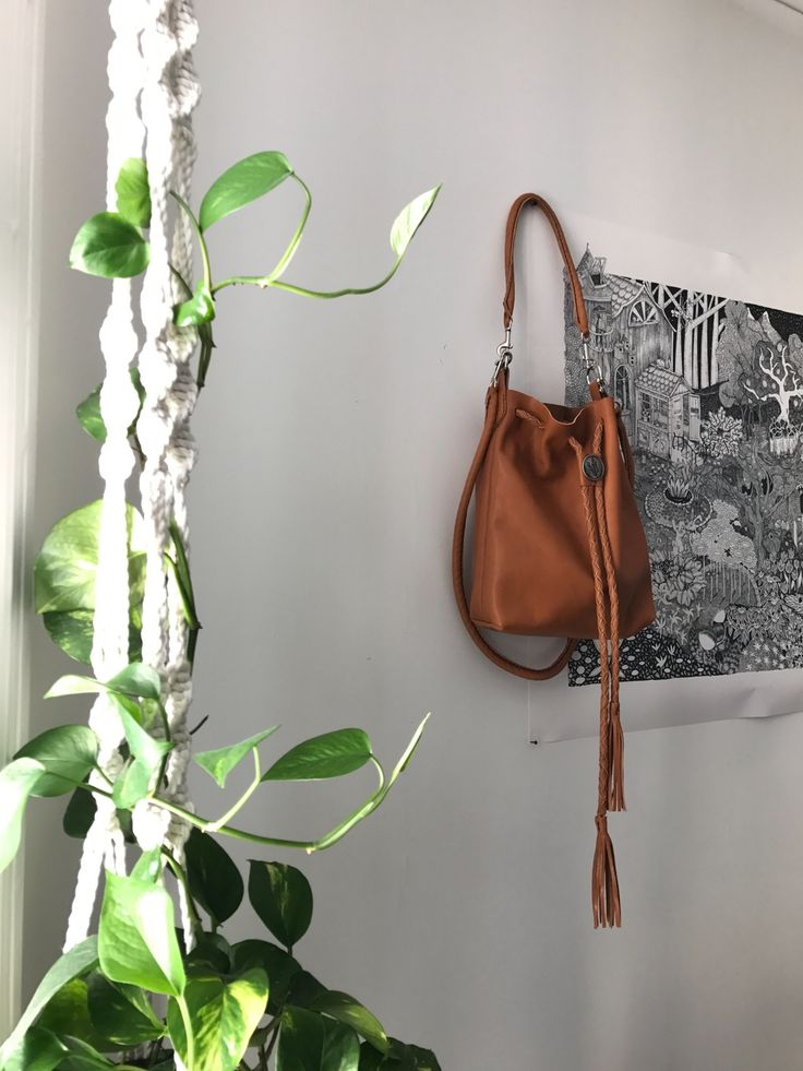 The product • Bucketbag Spanish Brown & Silver • is sold by • Jenny Lou Store • in our Tictail store. Tictail lets you create a beautiful online store for free - tictail.com