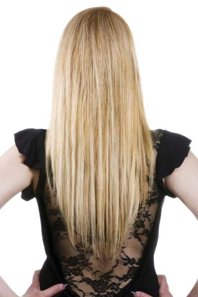 more daring and modern, check out this great V-shaped long hairstyle. This look is great for thick hair, replacing bulk with shape and movement. The dramatic point really emphasizes the length of hair and draws attention to your back.