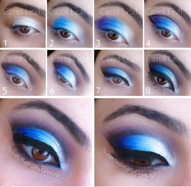 """1 - Depois de aplicar um fixador, passe branco até a metade da pálpebra.  2 - Passe um azul claro no centro da pálpebra .  3 - Passe roxo ou azul marinho no final.  4 - Marque o côncavo com preto, e termine com um """"V"""" no final da pálpebra.  5 - Esfume o preto com um rosa envelhecido.  6 - Aplique um pigmento/glitter branco no canto dos olhos.  7 - Passe delineador.  8 - Passe rímel e cole os cílios (colei só no final, fica bem delicado) :D"""