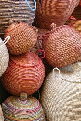 At market in Dakar. Find fair trade baskets from Senegal at swahilimodern.com.                                                                                                                                                     More