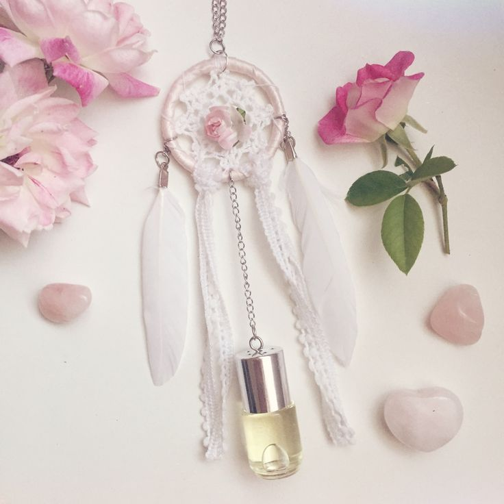 Small white and pink car dreamcatcher with natural feathers, pom-pom trim, tiny rose  http://www.longlostdreams.com.au/product/antique-rose-scented-car-dreamcatcher