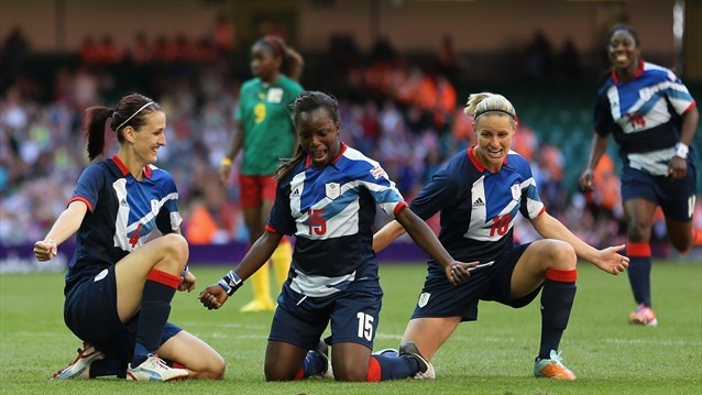 Jill Scott of Great Britain celebrates scoring with team mates Eniola Aluku and Kelly Smith during the Women's Football first round Group E Match against Cameroon on Day 1 of the London 2012 Olympic Games at Millennium Stadium in Cardiff.