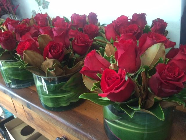 Red rose table centres - www.bloominboxes.com.au