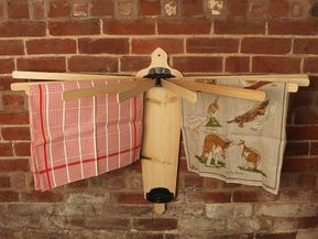This traditional wall mounted clothes airer is a great addition to any period home. A lovely traditional style wooden airer with a clever modern space saving design thats quick and easy to use. To use simply pull out its 10 laths and place the groove on the cast iron holder at the top.
