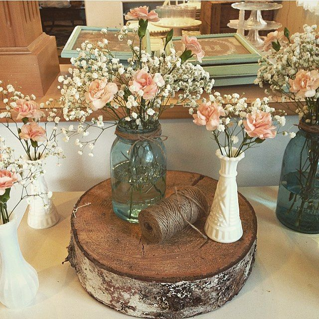 Baby's breath & pink carnations. vintage mason jars, milk glass, wood rounds  #bridalshower #weddingdecor
