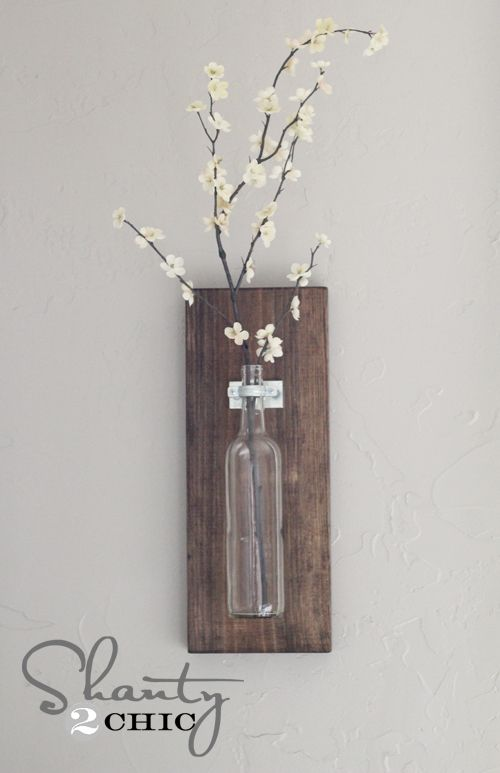 I've been trying to figure out what to do with some of my favorite recycled wine bottles. This is perfect! And cheap =)
