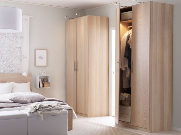 Ikea- A bright bedroom with PAX wardrobe and MALM bed in light oak, plus a white DVALA quiltcover.